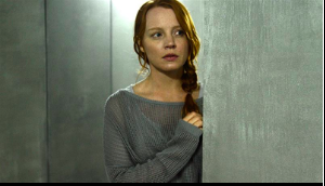 "Actress Lauren Ambrose amidst the cold, sterile interiors from the cult compound on USA Network's ""THE DIG"" TV series"
