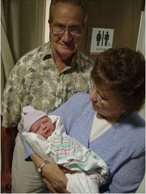 Mom and Dad, who was just minutes old. Pensacola, FL, 2003.