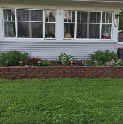 The beautiful flower bed Christopher helped build and plant with his mom.